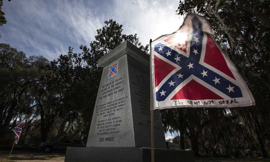 A monument honoring Confederate Gen. Nathan Bedford Forrest stands with the Confederate Flag. Monuments like these are still prevalent in the United States. Now, faced with much opposition states have been taking down Confederate memorabilia from state property.