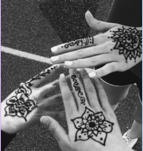 Friends pose for a picture of their henna at Relay for Life. At Relay for Life, students participated in many fun activities, including getting henna. The practice has been going on for thousands of years.