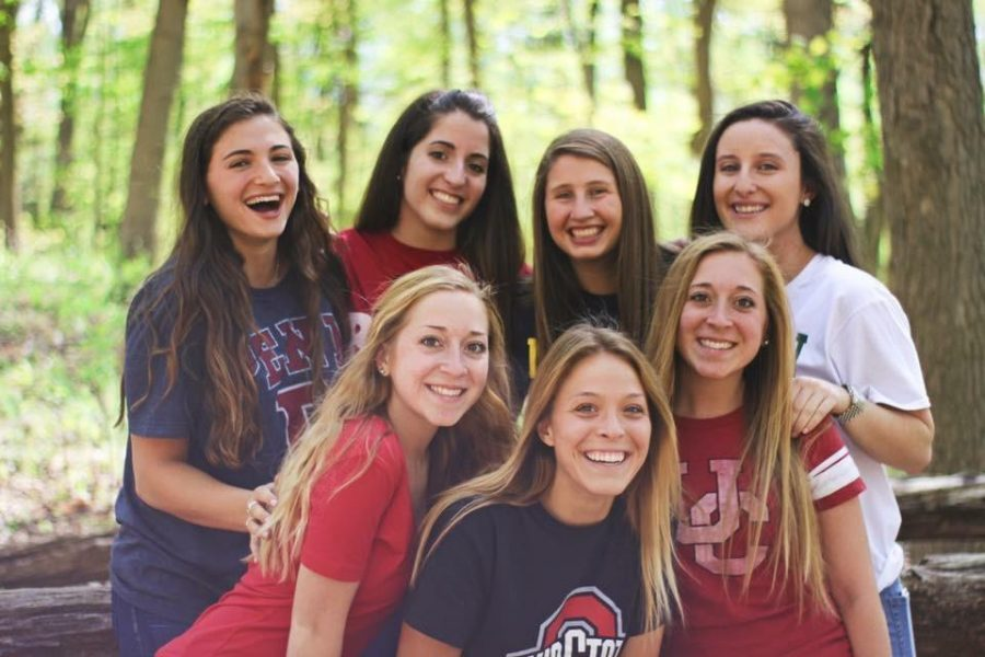 Seniors Raquel Levitt, Camila Cardenas, Melissa Goodman, Ali Richter, Orion Schlosser, Lydia Deppert, and Zoe Schlosser pose for a group photo with their college shirts. Seniors are encouraged to wear shirts for their future plans on Fri. May 13. There will be ice cream as well as posters to sign courtesy of the PTO.