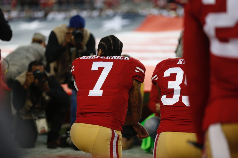 Colin Kaepernick (7) has been making headlines for the silent protest he has been taking part in during opening NFL games. He has elected to not stand during the National Anthem. This has started a national debate on freedom and the meaning of the flag.
