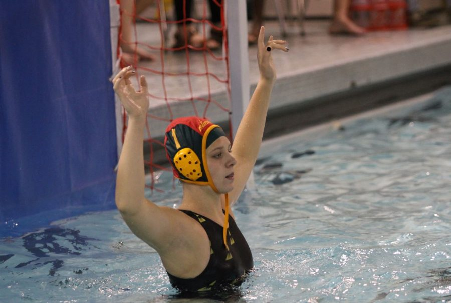 Junior goalie, Abigail Hausefeld readies herself to block a shot.  Hausefeld is a member of the junior varsity swim team outside of water polo season. She is unsure of her athletic plans for after high school.