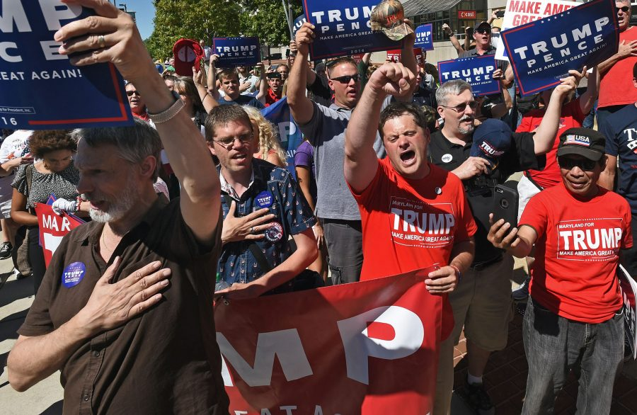 Donald Trump supporters staged a rally on Monday, Sept. 12, 2016 across the street from the Baltimore Convention Center, where Trump addressed a gathering at the National Guard Association of the United States conference. (Kenneth K. Lam/Baltimore Sun/TNS)