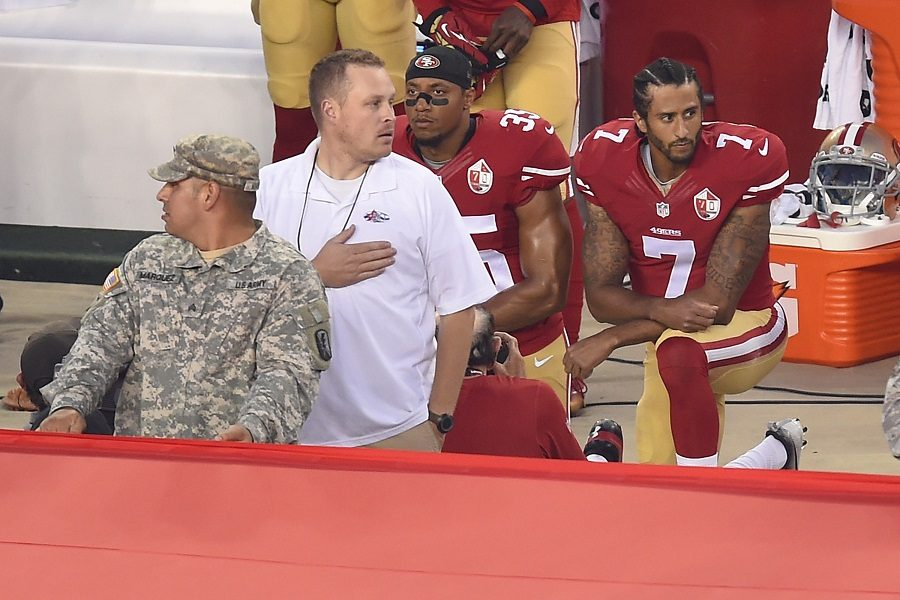Backup quarterback for the San Francisco 49ers Colin Kaepernick and teammate safety Eric Reid are kneeling during the national anthem on Mon., Sep. 12. This is Kaepernick's third game of not standing during the anthem, the previous two being during the preseason. His actions has spread throughout the week, while other teams are standing united.