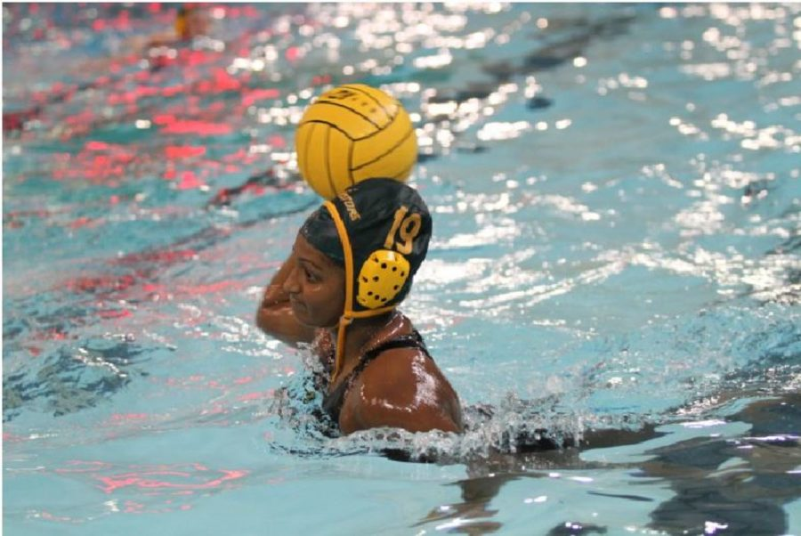 Sarah Abraham, 11 looks to pass the ball to a teammate. Abraham is one of the perimeter player starters for the 2016 season. She also swims competitively and plays water polo for the Moose Water Polo Club team.