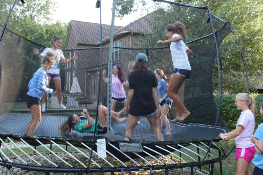 Many+of+the+girls+on+the+cross+country+team+enjoy+getting+out+some+energy+before+eating.+They+play+games+like+pop+corn+and+blind+tag+while+on+the+trampoline.+It+leads+to+many+giggles+and+sometimes+a+lot+of+competition.+