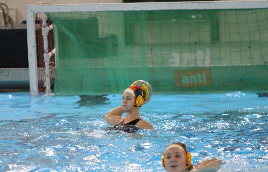 Abigail Hausefeld, 11 looks to release the ball after making a save. Hausefeld plays for the club water polo team Moose Water Polo in the off season. She is interested in continuing her playing at the collegiate level.