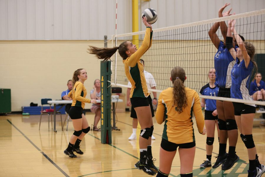 High Hitting. Meredith Ringer (9), member of the freshman volleyball team, sets the ball over the net. Their game took place on September 13th.