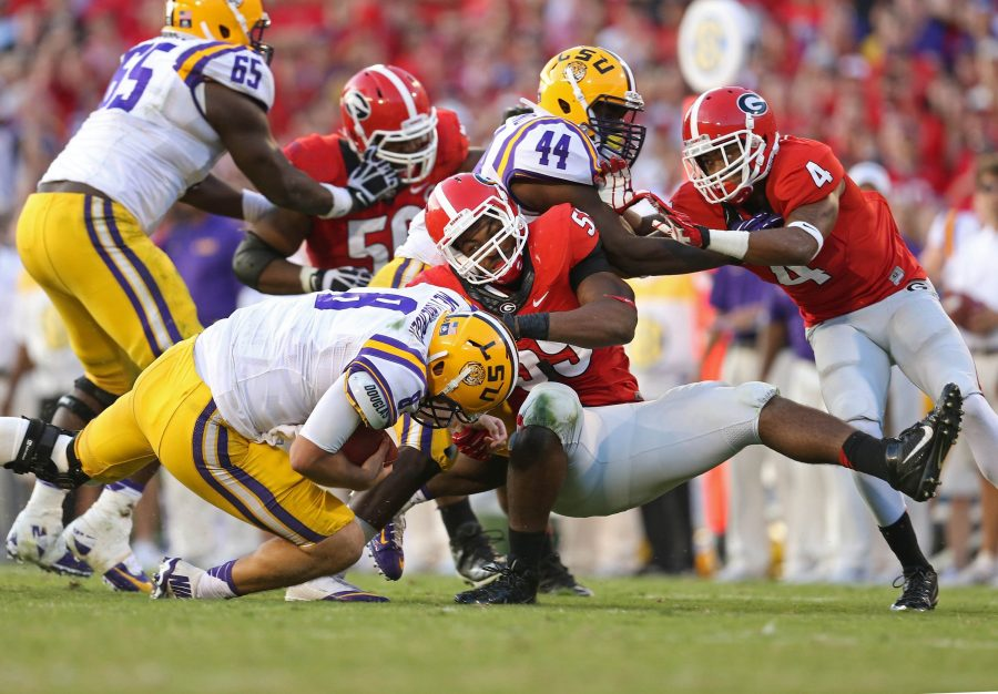 Caption: Louisiana State University is doing something during a game on versus a team. Due to extreme weather conditions, they had to cancel a game versus Florida and had to reschedule for Noveber 19 and change the location from at Florida to at LSU. This controversy and decision was highly publicized since neither side could agree on a solution.