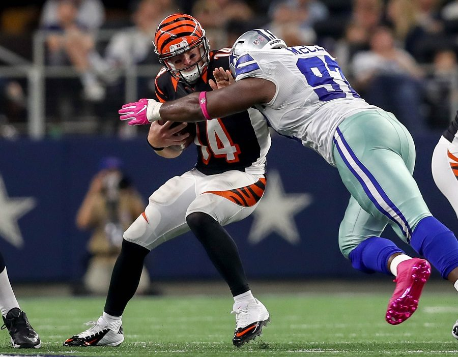 Cincinnati Bengals quarterback Andy Dalton is sacked by Dallas Cowboys defensive tackle Terrell McClain during a game in Dallas on Sun., Oct. 9 that resulted in a 28-14 Cowboys win. The Bengals played the Washington Redskins in London on Sun., Oct. 30, and the teams tied 27-27. The second week with a tie have brought up the conversation again of fixing the overtime rules.