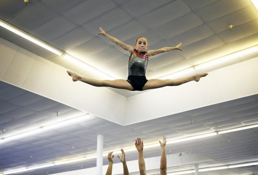 At age 9, Abigail Morierty is practicing her acrobatic flips with her partner. Acrobatics gymnastics is not in the Olympics. However, men and women's artistic and rhythmic gymnastics can be found in the Olympics. Photo by: MCT campus