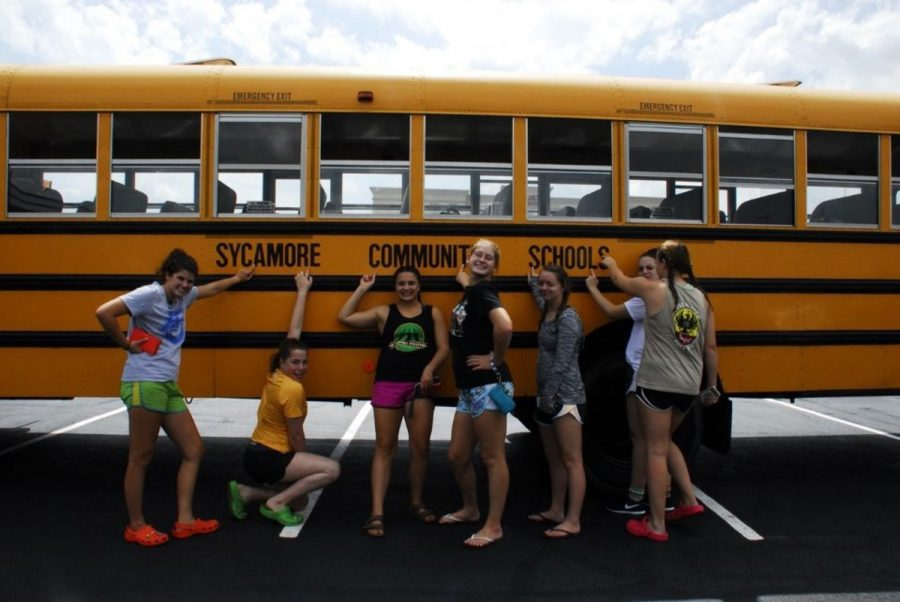 The team poses by a bus at their tournament at Princeton High School. They often have games a few hours apart. In between games, the team will get lunch together and hang around the pool and watch other teams play.