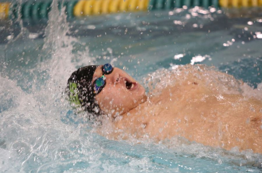Jiho Choi, 12 competes in his best event- the 100 yard backstroke. Choi was a state qualifier for a relay as a freshman, however had to take a break from the sport due to injuries his sophomore year. As a senior, he hopes to return to the state meet.