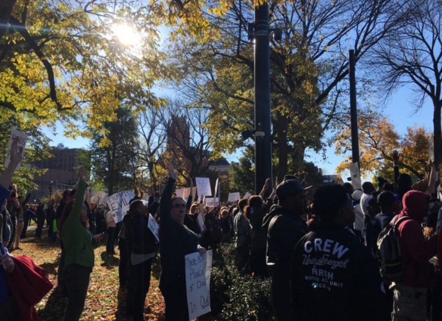 SPEAKING OUT. Protesters stop to listen to speakers at Washington Park during protesting. Speakers from various organizations such as BLANK spoke out about their feelings and experiences with racial problems in our city.