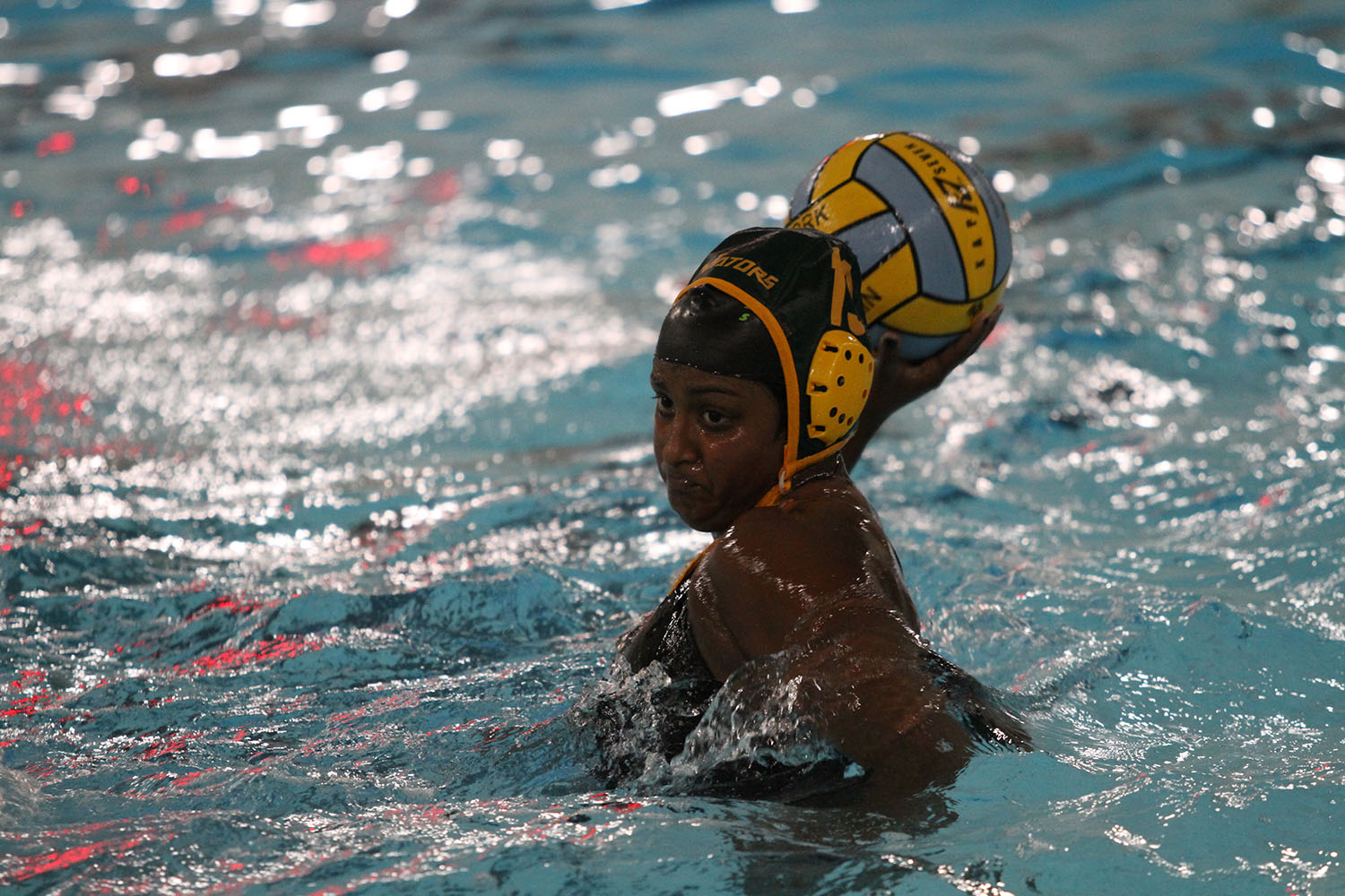 """MY SHOT.  Junior Sarah Abraham takes a shot from the five meter line. Abraham was a starting varsity player and has been a member of the SHS water polo team since freshman year. """"We ended up doing really well after we were struggling at the beginning of our season,"""" said Abraham."""