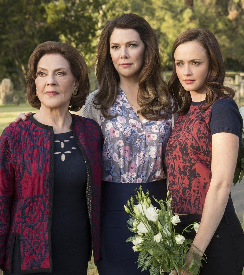 Emily (Kelly Bishop), Lorelai (Lauren Graham), and Rory (Alexis Bledel) look on. The three characters return along with all of the original cast for the revival series, 'Gilmore Girls: A Year in the Life.' The four 90 minute episodes are streaming on Netflix now.