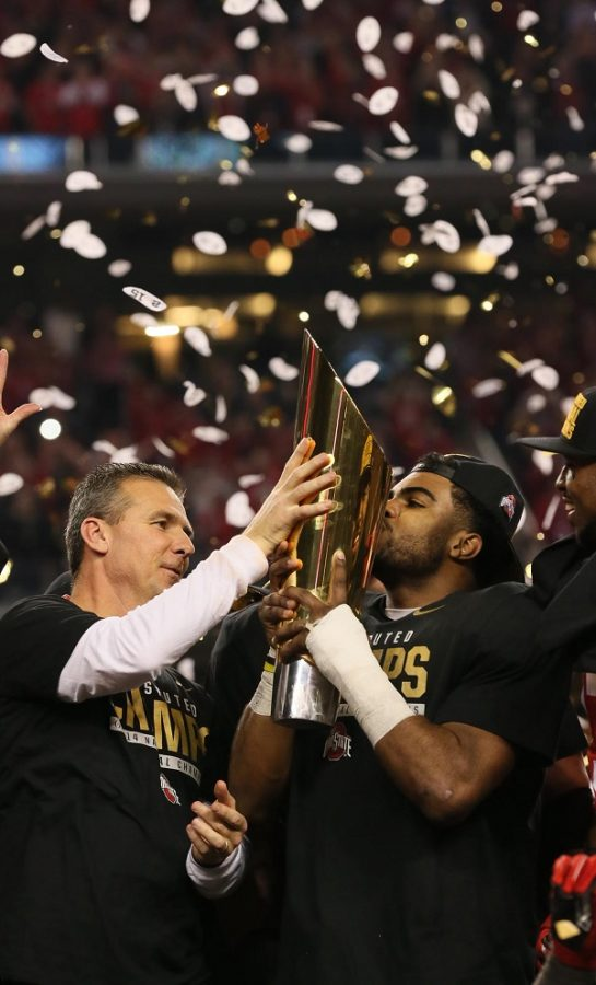 The Ohio State University football coach Urban Meyer and former running back Ezekiel Elliott are celebrating their eighth national championship. They won the first title in the new playoff system for college football. While the new system has had remarkable success, the way conferences chose the champions has been a highlighted flaw.
