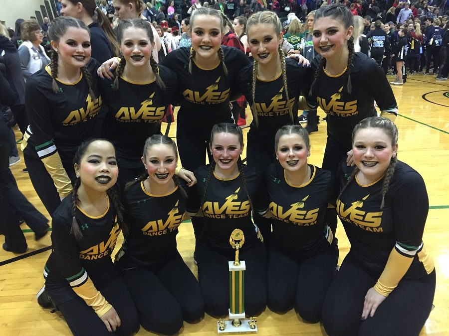 The Aves Dance Team pose with their newly earned trophy on Sat., Jan. 6 at Seton High School. They competed in the small Varsity Hip-Hop Division. Kings and Archbishop McNicholas High School placed above them, while Campbell County High School placed below; it was a tight division where the only difference between first and fourth place was eight points.