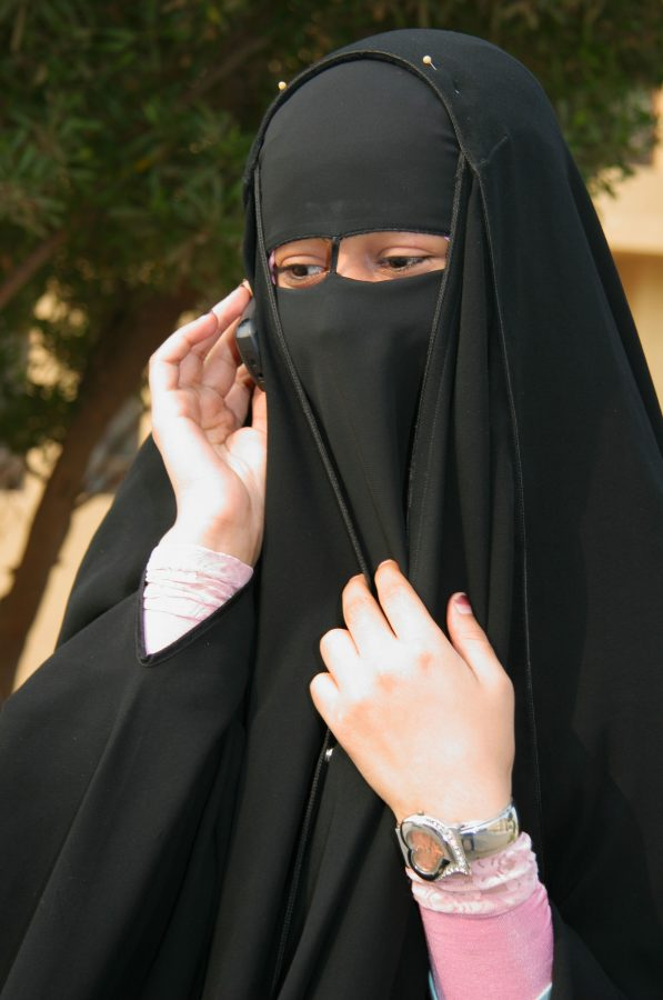 A young Muslim woman wears a niqab. These headcoverings have come into question with the discussion of Islamophobia, and Austria's ban on full-face veils has sparked debate. Islamophobia is a prevalent issue around the world, especially with Trump's new travel regulations.
