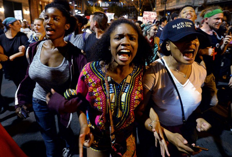 Protesters with the Black Lives Matter movement. They are marching in Charlotte, N.C. They are  following the shooting death of Keith Scott by police. The Black Lives Movement has become a huge, national movement.