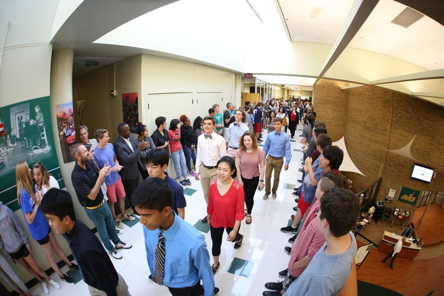MERIT MARCH. The hallways are lined with students as they cheer on the nationsl merit students and their parents in their march of champions to honor their accomplishment.