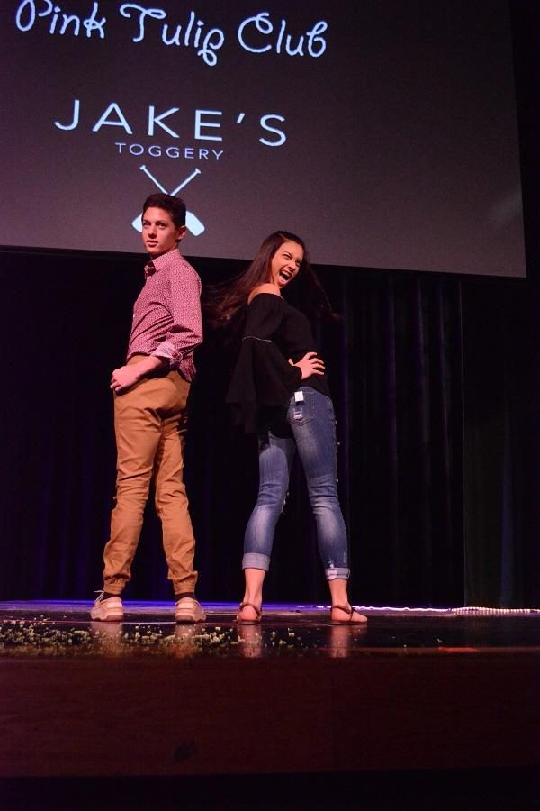 """SHOW STOPPERS. Sophomores Samantha Fernandez and Jordan Pescovitz strut down the runaway during the 11th annual Fashion For The Cure. In 2014, Sycamore teamed up with the Dragonfly Foundation permanently, after the need for supporting childhood cancer patients and their families increased; their goal for the 2017 show was $30,000.  """"The 14 girls on the committee worked very hard to make this event possible; I am very proud of all of them as well as the student designers,"""" said Deborah Klempt, FFTC staff adviser."""