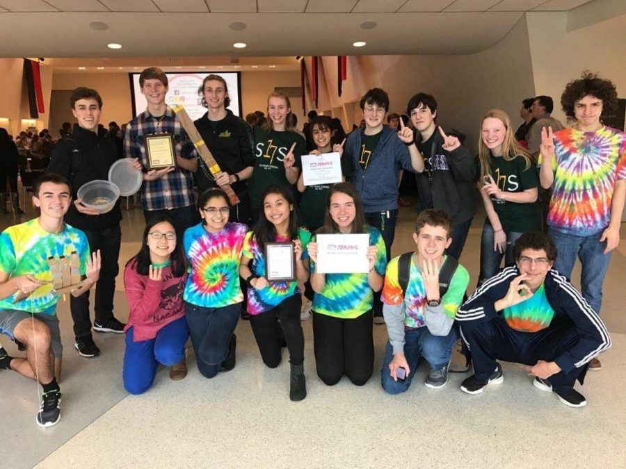 PUT YOUR HANDS UP. SHS' teams pose with their robot creations and awards. They were challenged to design and build mechanical hands to transport water bottles. The seniors received first overall and the juniors got third.