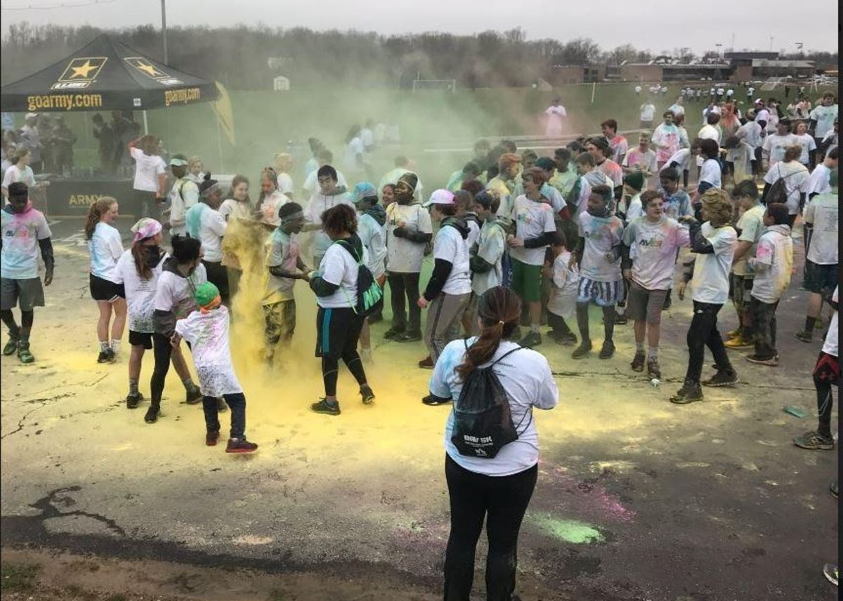 As pictured, many people's hands were temporarily stained by the paint. The paint was in a chalk format, but as it mixed with sweat or moisture it began to soak into the skin. For days on end, participants were trying to wash the color out of themselves; luckily all the paint was nontoxic and should not affect physical health in any way.