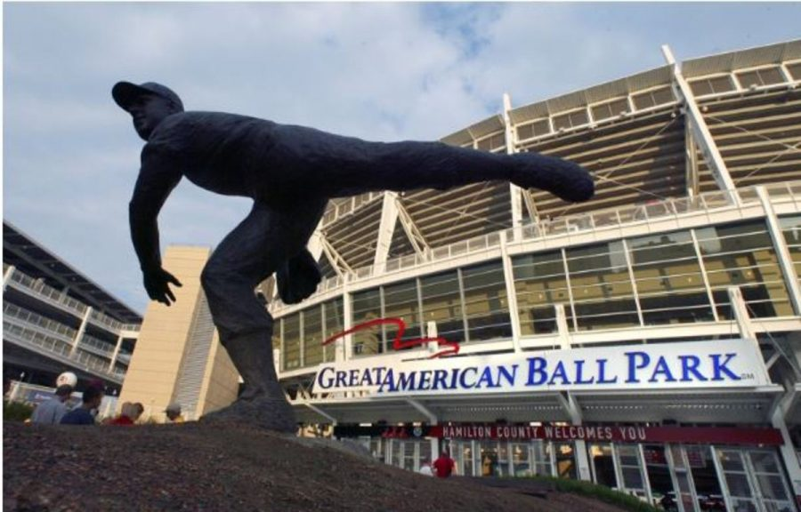 GO PLAY BALL. Former Reds player Joe Nuxhall's statue stands outside of Great American Ballpark. On April 3, the stadium will fill its near 43,000-person capacity for Opening Day. The game will feature the Reds and the visiting Philadelphia Phillies