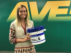 RECYCLE. Senior Alexandra Meckes poses with one of the containers for batteries. As she continues her project, she finds herself with an abundance of support by Sycamore-affiliated people. She hopes to see many more people getting involved and participating in recycling their used batteries.
