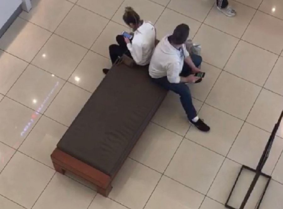 """TENSE. Junior Allie Ross went to Kenwood Mall and sat directly next to strangers for as long as possible. """"I could tell that [people] were uncomfortable and confused with the fact that I was not following the expectations of a personal space barrier, but I continued on anyway, Ross said."""