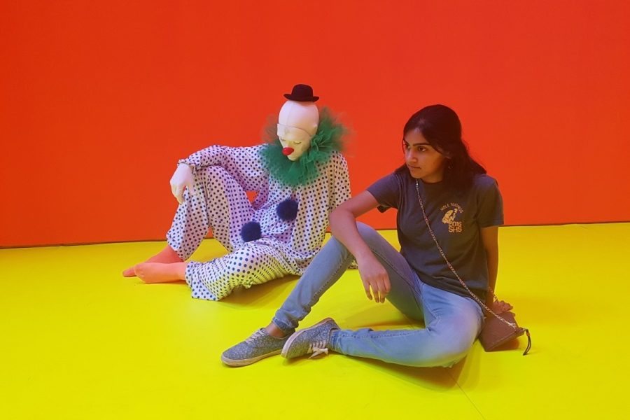 """POSE. Lavanya Konda, 12, contemplates with a clown at the art exhibit of Ugo Rondinone. Rondinone created the exhibit """"let's start this day again."""" It consists of 45 lifelike clowns representing different solitary actions such as """"breathe,"""" """"sleep,"""" """"meditate,"""" and more. """"I liked how realistic they appeared; I honestly thought one of them was going to jump up when I walked by,"""" Konda said."""