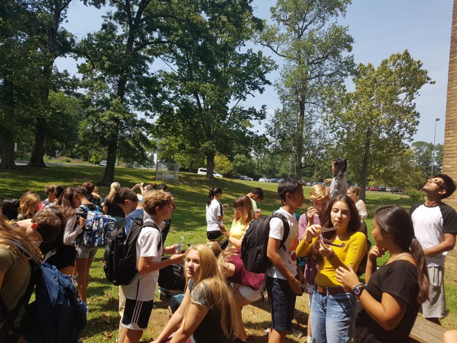ANTICIPATION. Seventh bell science classes view the eclipse through their special protective glasses. At SHS, students and teachers were in the path of 91 percent totality. The eclipse reached its peak at 2:29 p.m. Photos courtesy of Adhiti Chundur.
