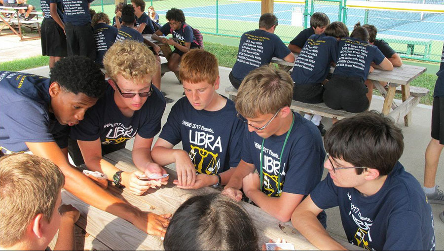 TOGETHER. Before performing their show Libra, the marching band enjoys a picnic. The band has yet to have their first competition but will Sat Sept. 9. The competition will be held at Kings High School and Libra will be shown around 9:00 pm.