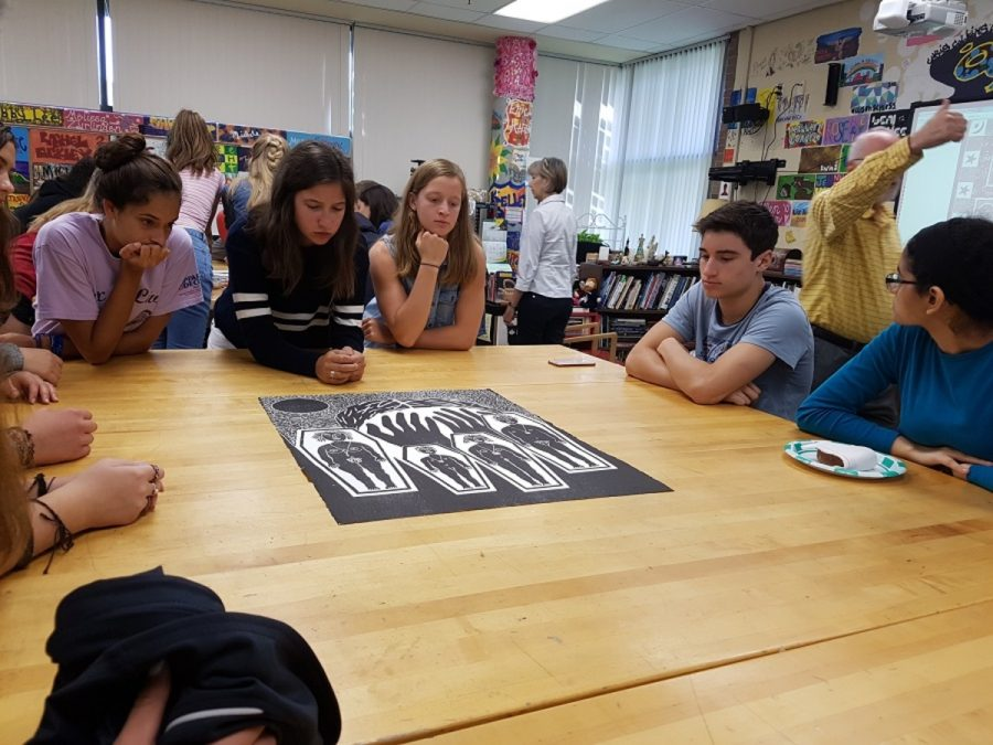 SOCIAL COMMENTARY. Art students in Mrs. Kat Rakel-Ferguson interpret prints by local artist Saad Ghosn. Ghosn is a local artist who creates woodcut prints that express different critiques of society and discrimination. The AP art students have various artists visits throughout the year to inspire them to create meaningful pieces.
