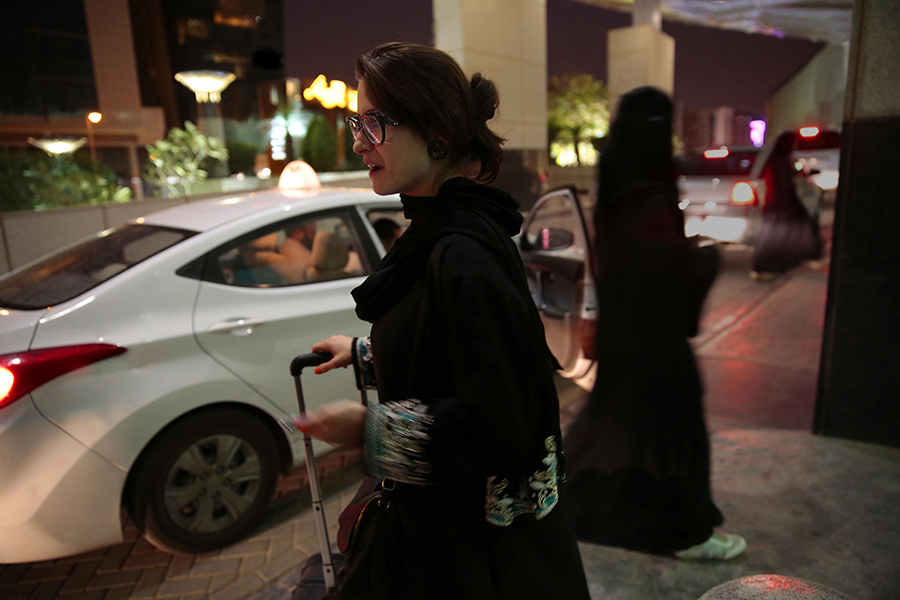 FINALLY. A women in Saudi Arabia waits for Uber to pick her up. The royal decree released on Tuesday will allow Saudi Arabian women to drive in June 2018. Until then, women will continue to pay for drivers or ask male relatives to drive them places.