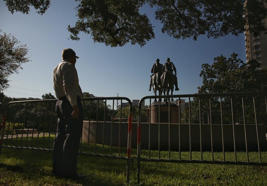 A man stops to view the statue of Confederate general Robert E. Lee in Robert E. Lee Park in Dallas on Thursday, Sept. 7, 2017. (Andy Jacobsohn/Dallas Morning News/TNS)