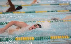 Swimmers dive into tryouts
