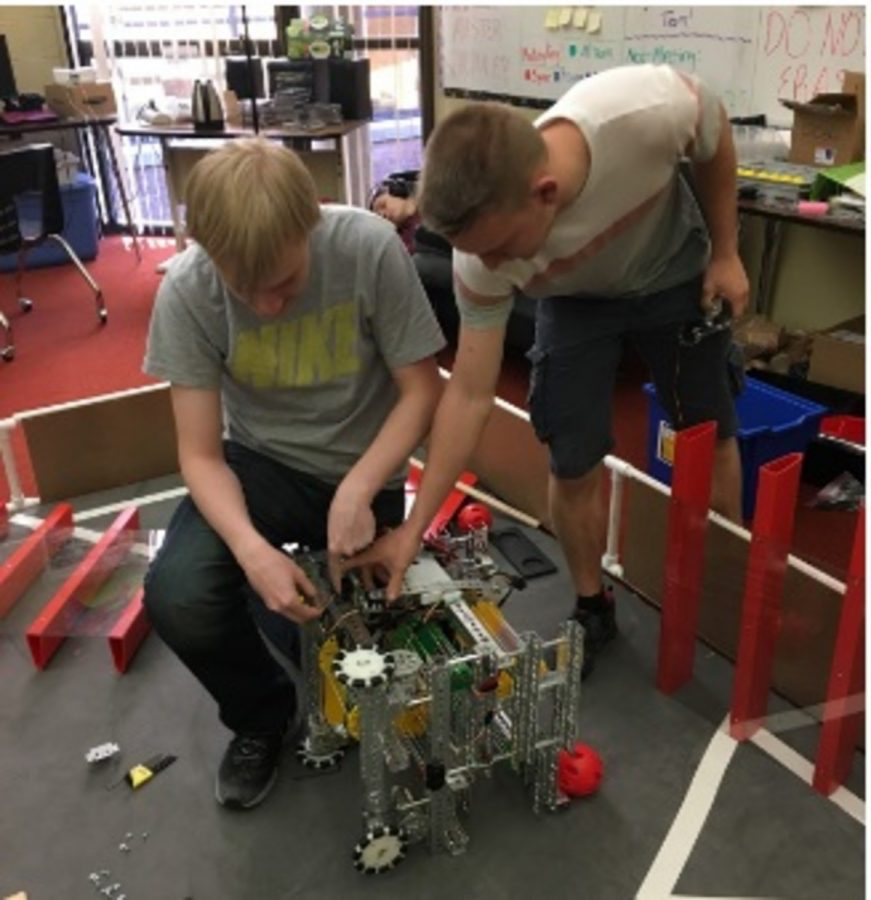 PROGRAM.+Juniors+Nick+McDonough+and+Phil+Bryant+work+on+their+robot+during+first+Aves+bell.+Both+students+have+a+love+of+Computer+Science+and+Programming%2C+and+although+Bryant+is+new+to+the+club%2C+he+has+had+experience+building+computers+on+his+own%3B+furthermore%2C+he+was+a+member+of+his+old+school%E2%80%99s+Science+Olympiad+Team.+%E2%80%9CI+build+computers+as+a+hobby%2C+but+I%27ve+not+really+done+robotics%2C+so+it%27s+nice+being+able+to+come+in+and+being+able+to+work+during+Aves+bell%2C%E2%80%9D+Bryant+said.