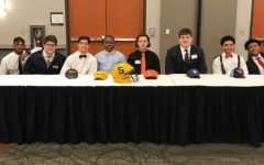 Athletes sign on Feb. 9