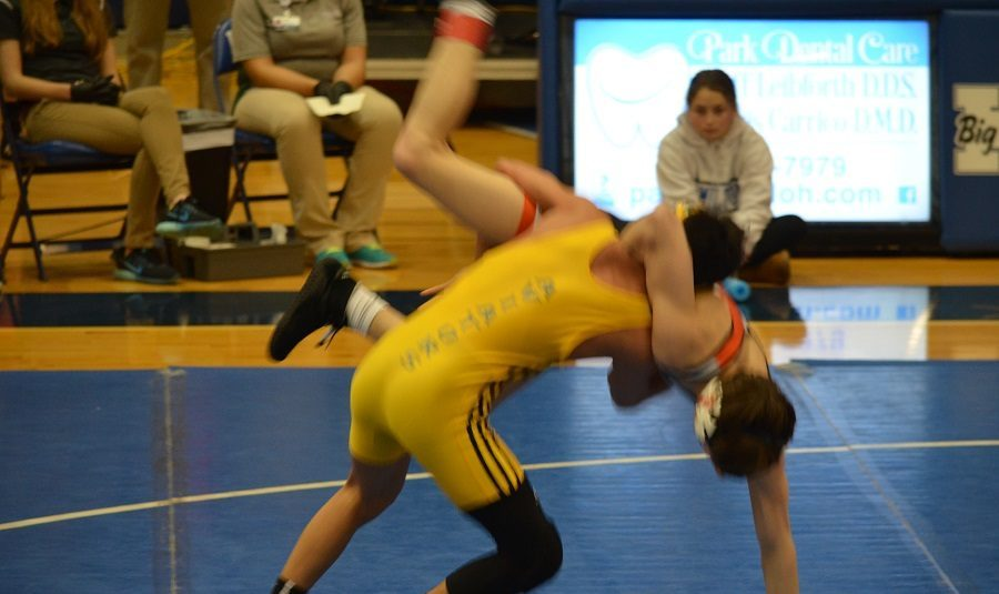 SLAM. Junior Jake Vayo-Smith gets a take-down in his quarterfinals match. Vayo-Smith won 9-3.