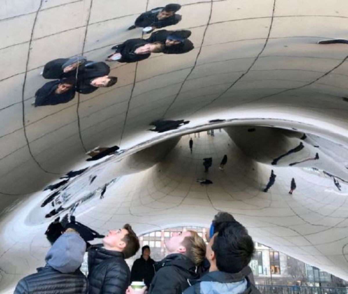 "BEAN THERE, DONE THAT Boys on the trip marvel at the enormity of the famed Millenium Park Bean before attending the conference later that day. For many of the club's five seniors, it was their final opportunity to do Model UN as a high school student. ""Chicago was a nice break from school, and I was able to get a unique educational experience. I formed connections with lots of people and also got to check out the city,"" said Nikhil Sekar, 12."