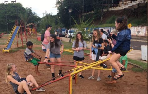 Students teeter-totter with local Argentinian children