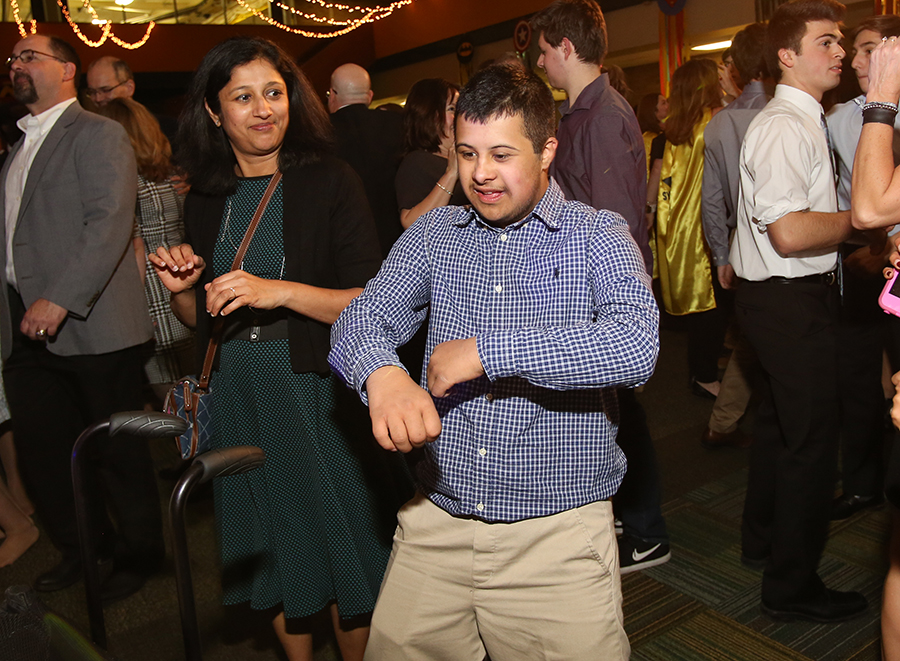 """BOGIE. Senior Vineet Narayan dances next to his mom. Last year's theme was """"Superheroes,"""" and dancers may dress to the theme."""