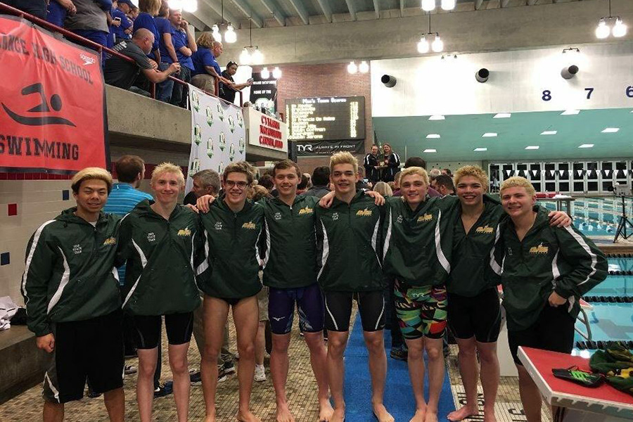 STATE CELEBRATION. Spirits soar when in the company of your teammates. At the 2018 OHSAA swim meet, the SHS boys team swam spectacular races. They placed third in the entire state of Ohio, a new high since 1992.