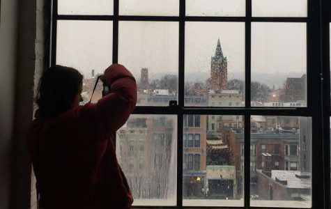 SNAP. Sophomore Chloe Mensch strives for the best angle at the Art Academy on Feb. 1. A goal of the New Voices program is to visit diverse locations that will spark creativity. Some examples of these are the Plum Street Temple, Memorial Hall, and even a ride on the streetcar.