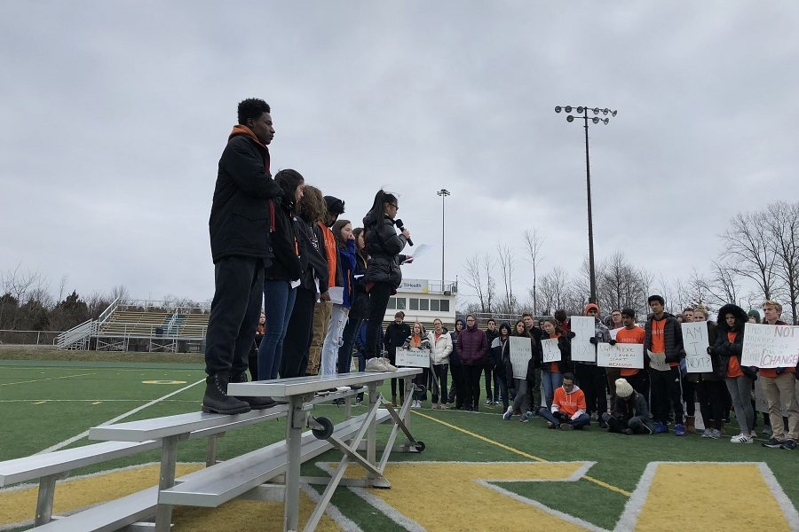 ENOUGH. Students stand in the soccer fields after walking out of the school at the end of third bell on March 14. They listened to 19 speakers as they relayed the stories of the victims of the Parkland shooting in Florida along with encouraging change. The walkout was entirely student-led and non-partisan.