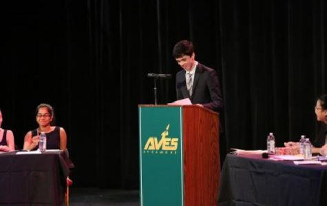 SPEAK UP. Junior Grant Brunner speaks at debate finals during last year's competition. Although most teachers do not allow students to pick their own groups for debates, debates are truly a team effort. Group members must rely on one another to connect speeches and write the rebuttal.