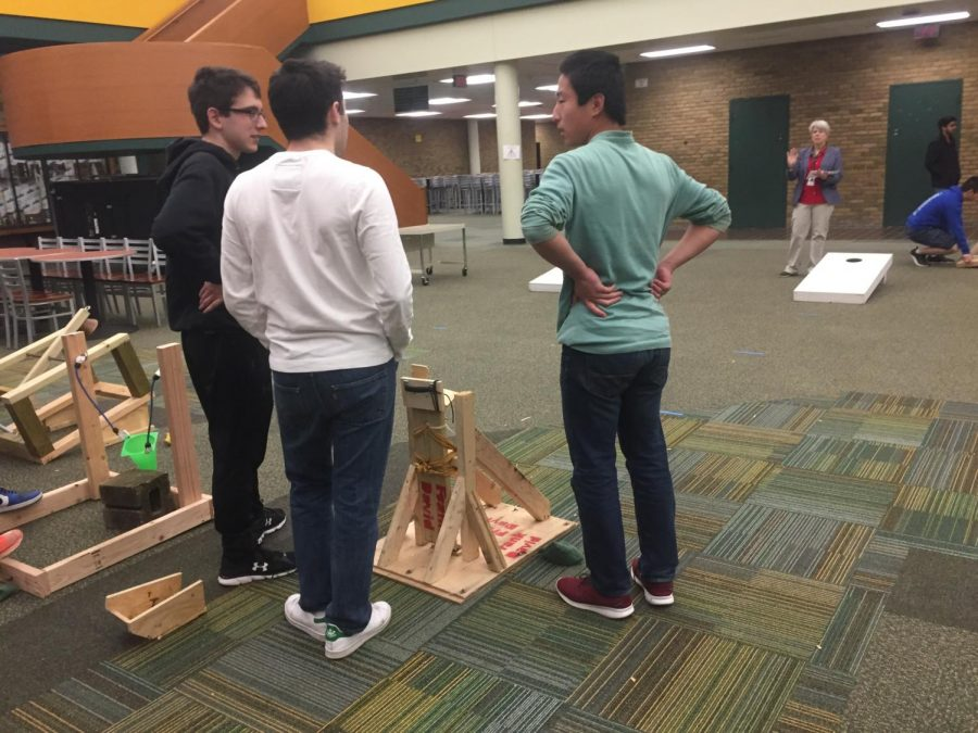 ESTIMATE.+Perhaps+more+difficult+than+getting+it+to+launch+20+feet%2C+getting+the+bean+bag+to+actually+go+into+the+hole+is+a+daunting+task.+Students+created+flingers%2C+catapults%2C+and+slingshots%2C+but+accuracy+was+not+guaranteed+with+any+of+these+methods.+A+durable+model+and+consistent+shooting+method+is+crucial+to+ensure+the+success+of+a+corn+hole+launcher.