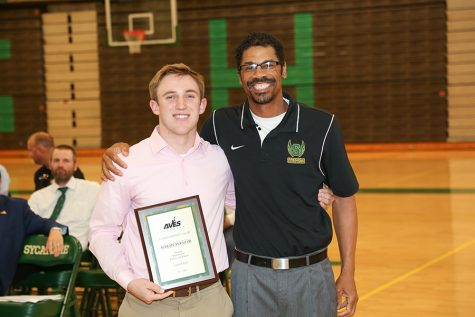 MANY DIFFERENT SPORTS. Jeremy Pletz receives 3,000 point club recognition for soccer, wrestling, and track and field totaling 3,450 points.