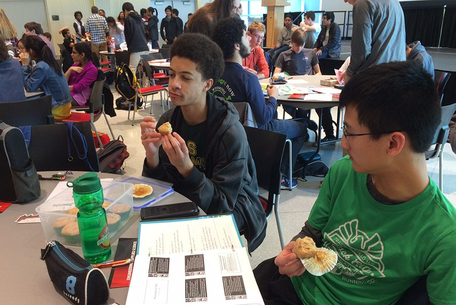 TEAMMATES. At the TEAMS district competition, sophomores Andre Harte and Chee Yin (Daniel) Leong bond over lemon muffins baked by teammate Caroline Skwara. Working together to prepare for the competition and complete challenges the day of was a bonding experience for the team, and they are excited to continue to work together for TEAMS competitions over the next two years.